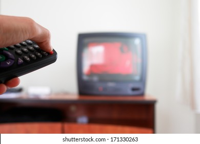 Television screen with tv remote control  in foreground.....