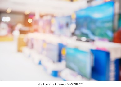 Television shelf in eletronic department store blurred background