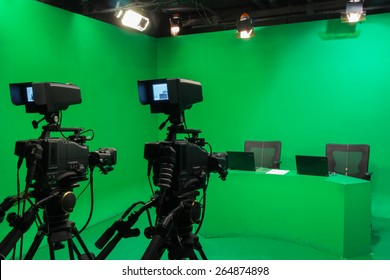 Television studio with camera and lights - camera on tripod: Shallow depth of field