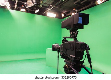 Television studio with camera and lights - camera on tripod