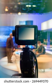 Television studio with camera and lights - recording TV show. Shallow depth of field - focus on camera