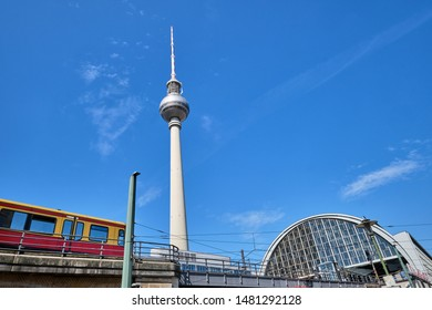 The Television Tower in Berlin with a commuter train entering the trainstation
