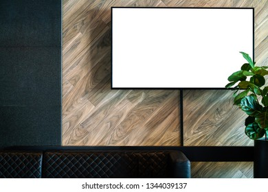 Television TV on wall in a living room, lounge, in a relaxing room