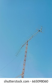 televisions antennas with blue sky in background