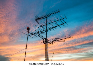 televisions antennas with sunset cloudy sky background