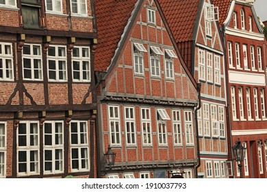Telezoom view to refurbished red brick houses in small town of Germany
