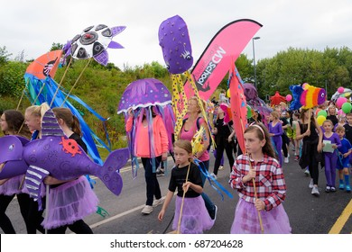 TELFORD, SHROPSHIRE, ENGLAND - JULY 15 2017: Participants at the carnival of the Giants parade in Telford, Shropshire.
