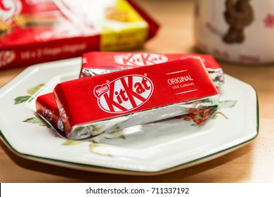 TELFORD, SHROPSHIRE U.K. - 6 SEPTEMBER 2017 Still Life of three KitKats on a side plate, with a mug of tea in the background, and a KitKat package to the top left hand side