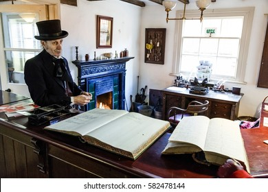 TELFORD, UK - CIRCA 2013: An actor dressed in Victorian costume, The Estate Office, Blists Hill Museum, Shropshire, UK