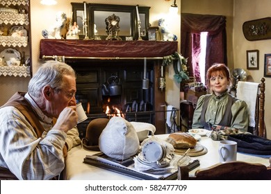 TELFORD, UK - CIRCA 2013: Actors dressed in period costume drink tea at Blists Hill Victorian Museum, Ironbridge, UK