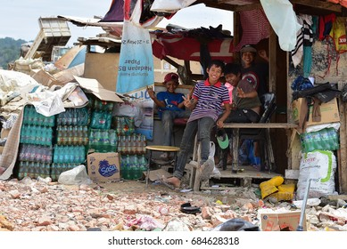 Telipok Kota Kinabalu Sabah Malaysia - July 02, 2017 : Some boys are resting in a cottage in a garbage collection area