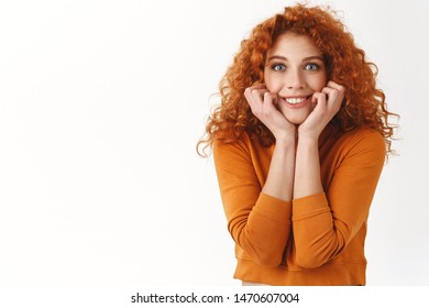 Tell me everything. Cheerful excited redhead female friend wanna know details gossiping, smiling thrilled, touch face and stare camera overwhelmed, watch favorite show, looking breathtaking concert