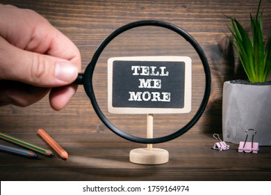 TELL ME MORE. Business, information, advice and solutions concept. Man's hand, holding magnifying glass - Shutterstock ID 1759164974