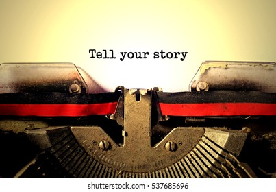 tell your story typed words on a vintage typewriter