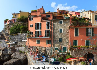 Tellaro, Italy, -  August 20, 2017: bathers in Tellaro, an old small characteristic village in the Gulf of La Spezia in Italy.