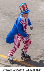 TELLURIDE, COLORADO, USA - July 4, 2018 - Annual  Independence Day Parade, Telluride, Colorado Colorado Avenue shows Uncle Sam on Roller Skates
