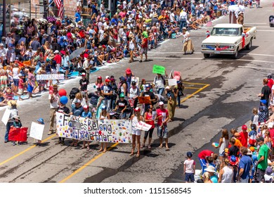 """TELLURIDE, COLORADO, USA - July 4, 2018 - Annual  Independence Day Parade, Telluride, Colorado Colorado Avenue - features banner """"FAMILIES BELONG TOGETHER"""""""