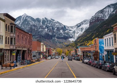 Telluride, Colorado, USA - October 14, 2018 : Colorado Avenue in Telluride facing the San Joan Mountains. Telluride is a historic mining town and popular ski resort.