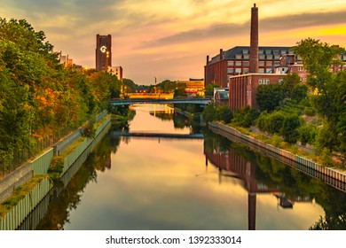 The Teltow Canal in Berlin-Tempelhof, Germany, overlooking bridges and old factory buildings in the light of the setting sun.