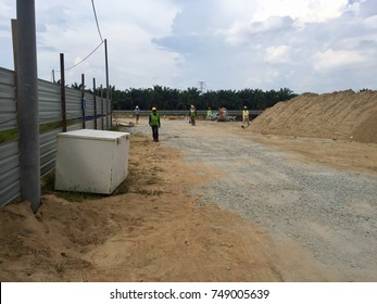 TELUK INTAN, MALAYSIA - NOVEMBER 02,2017 : Unidentified construction worker walking to muster station and participate in headcount drill.