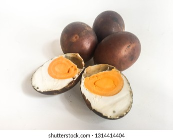 Telur asin Bakar or Asap or Smoked salted egg isolated on white background. food culinary from indonesia, black color smoked salted egg. Indonesian culinary.