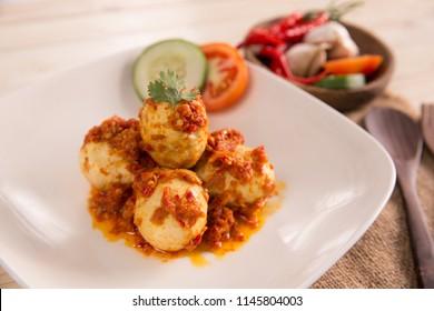 telur balado, boiled egg served with tomato and chili paste, or sambal. indonesian food