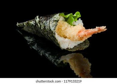 Temaki Ebitem sushi with tempura jumbo shrimps, teriyaki sauce and fresh salad on black background