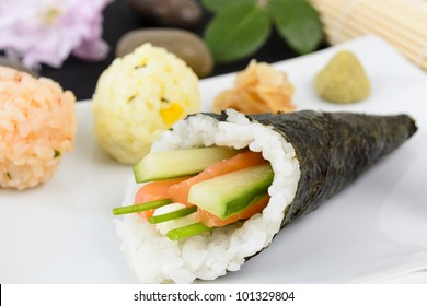 Temaki - Japanese hand rolled sushi with salmon, soft cheese chives and cucumber served with pickled ginger and wasabi.