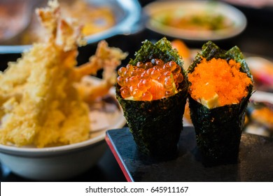 Temaki sushi with salmon and shrimp roe. Ikura (Salmon Roe) and Ebiko (Prawn Egg), California or Temaki Sushi Hand Roll.