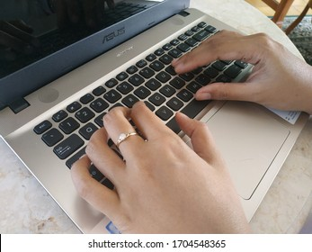 Temanggung, Central Java Indonesia, 15 April 2020, Work From Home using laptop Asus, gold rings on female fingers