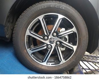 Temanggung, Indonesia - December 1, 2020: Car wheels Toyota, on the blue carpet