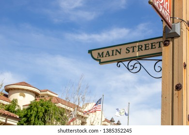 Temecula, California/United States - 04/08/2019: The Temecula City Hall buildings and wooden Main Street intersection sign