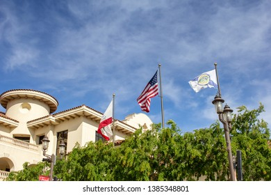 Temecula, California/United States - 04/08/2019: Flags waving in the wind at Temecula City Hall
