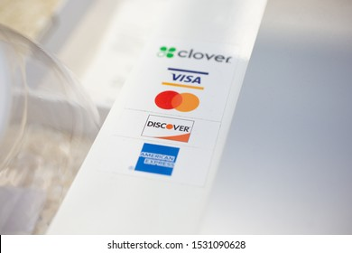 Temecula, California/United States - 09/04/2019: Several credit card company logos on a transaction payment kiosk, featuring Visa, Mastercard, Discover, and American Express