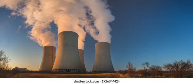 Temelin, Czech republic - 02 28 2021: Nuclear Power Plant Temelin, Steaming cooling towers in the landscape at sunset