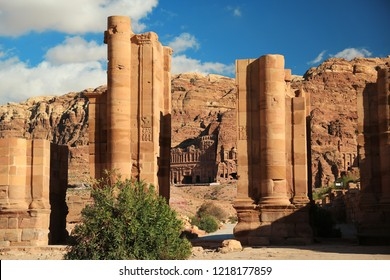 Temenos Gate and Colonnade Street in Petra - ancient historical and archaeological rock-cut city in Hashemite Kingdom of Jordan. Royal Tombs carved in the mountain on the background
