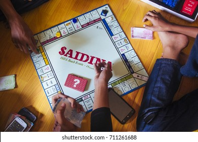 TEMERLOH, PAHANG - SEPTEMBER 1, 2017 : Group of kid playing Saidina board games. The classic real estate game.
