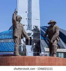 Temirtau, Karaganda/Kazakhstan - September 06, 2017: Monument of Metallurgists with first President Nursultan Nazarbayev (left). Historical and cultural center park area.