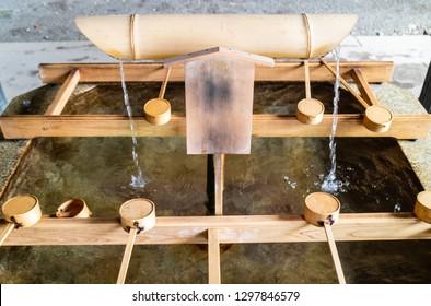 Temizuya - water basin for ritual ablution in Japanese temple