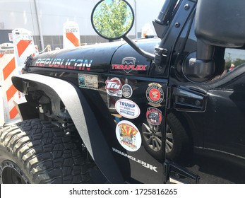 Tempe, Ariz. / US - May 8; 2020: A jeep with Republican bumper stickers parked at Costco as anti-government protesters push to reopen the economy and boycott businesses that require masks. 3054
