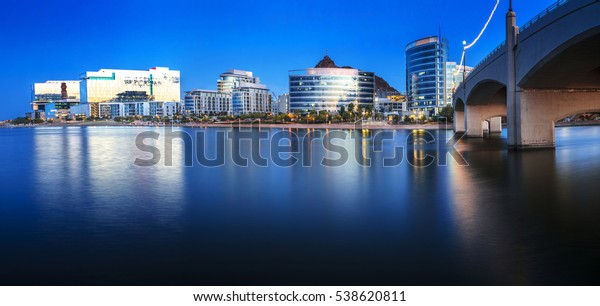 Tempe Arizona photographed from the Salt River during blue hour.