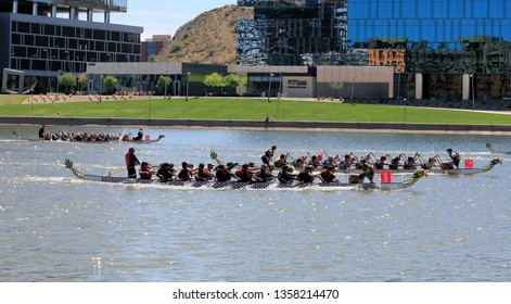 Tempe, Arizona / United States - March 30, 2019: Unnamed teams race across Tempe Town Lake during the Dragon Boat Festival.