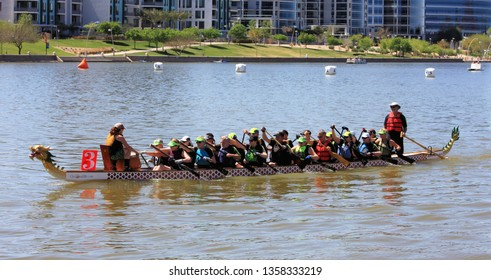 Tempe, Arizona / United States - March 30, 2019: Unnamed team rows into position before the start of the race at the Arizona Dragon Boat Festival on Tempe Town Lake in Tempe, Arizona.