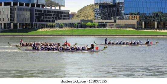 Tempe, Arizona / United States - March 30, 2019: Unnamed teams race toward the finish line during the Arizona Dragon Boat Festival on Tempe Town Lake in Tempe, Arizona.