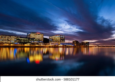Tempe, Arizona, USA - February 25, 2017: Tempe Town Lake reflects the downtown Tempe city skyline at sunset.