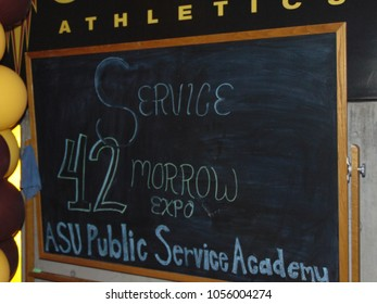 Tempe, Arizona /USA-04.23.2016: Chalkboard sign saying Service 42 Tomorrow, ASU Public Service Academy