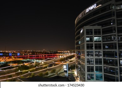 TEMPE, AZ - JANUARY 15: KPMG tower overlooking the Mill Avenue Bridge over Tempe Town Lake at night on January 15, 2014 in Tempe, AZ. KPMG is located just north of Arizona State University (ASU).