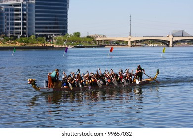 TEMPE AZ - MARCH 31: A single unidentified teams drifts along Tempe Town Lake during the Dragon Boat Festival on March 31, 2012.