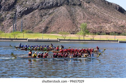 TEMPE, AZ - MARCH 31: Three unidentified teams race to the finish line at the Dragon Boat Festival at Tempe Town Lake on March 31, 2012.