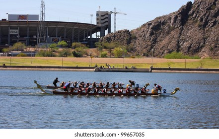TEMPE AZ - MARCH 31: Two unidentified teams racing along Tempe Town Lake at the Dragon Boat Festival on March 31, 2012.